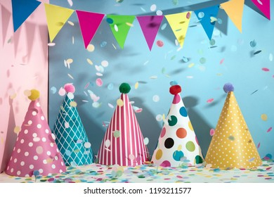 Colorful hats,flag garland and confetti for celebration