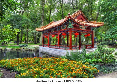 Colorful HDR image of Chinese pavilion and temples at the Chinese Garden at Lazienki Park, Warsaw, Poland