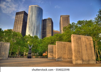 Colorful HDR image of the financial district skyscrapers buildings and the memorial of the servicemen who died in coastal waters of the western Atlantic Ocean in WW2 Battery Park - Manhattan, New York