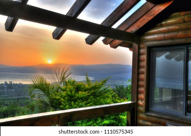 Colorful HDR image of a romantic and pastoral view of the Sea of Galilee from a wooden hut at the Golan Heights, Israel during sunset