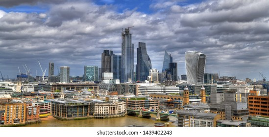 Colorful HDR image of the skyscrapers of London: Modern City of London on beautiful cloudy sky - panoramic image