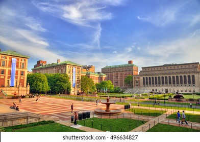 Colorful HDR image of students and faculty members walking near the famous Central Quadrangle and Butler Library at the Columbia University, New York City on a summer blue sky