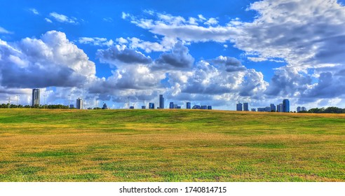 Colorful HDR image of the Yarkon Park with its famous green areas and the skyscrapers of Tel Aviv and Ramat Gan on a beautiful cloudy sky - panoramic image