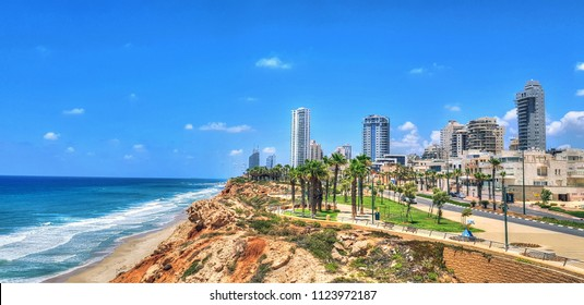 Colorful HDR and panoramic image of the coastline (Northern shore) of Netanya,  a city and a resort town in the Northern Central District of Israel on blue cloudy sky
