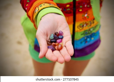 Colorful healing stones in kid's palm