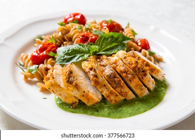 colorful and healthy chicken dinner with whole wheat pasta