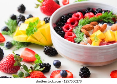 Colorful, healthy foods , fruit salad in white ceramic bowl