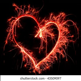 Colorful heart fireworks over dark sky , Saint Valentines card