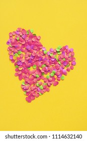 colorful heart formed with confetti