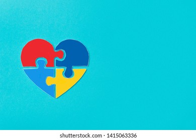 A colorful heart made of symbolic autism puzzle pieces
