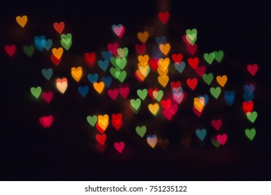 Colorful Heart Shaped Bokeh on Black Background