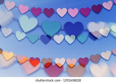 Colorful hearts on blue background