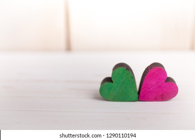 A colorful hearts on a wooden background