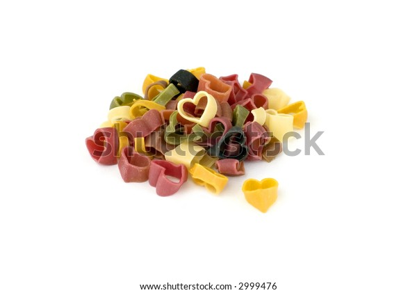 Colorful hearts of pasta on white background