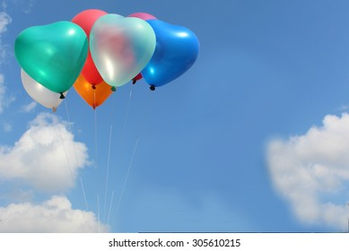 The colorful heart-shaped balloons with blue sky background