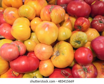 Colorful heirloom tomatoes on display at supermarket