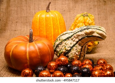 Colorful helloweens pumpkins  on the cloth sack background / Selective focus and Dark tone.
