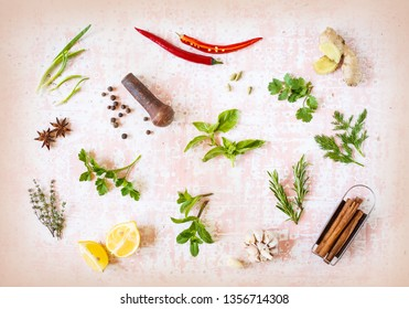 Colorful herbs and spices for cooking food on old vintage background