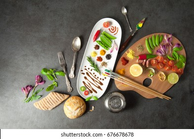 Colorful herbs spices and fresh ingredients on a painters palette