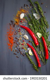 Colorful herbs and spices isolated on blue wood.