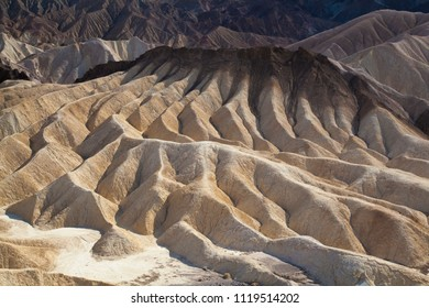 colorful hills at death valley hills at sunrise