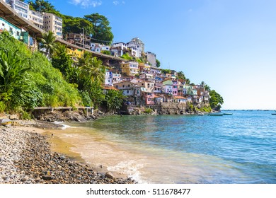 Colorful hillside favela architecture of the Solar do Unhao community overlooking the Bay of All Saints in Salvador, Bahia, Brazil