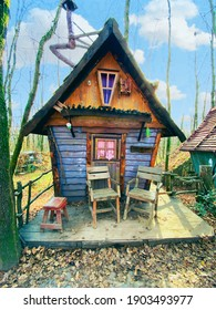 Colorful hobbit houses inside forest between long forest trees in fall winter. Hobbit village fantastic photos like a fable story
