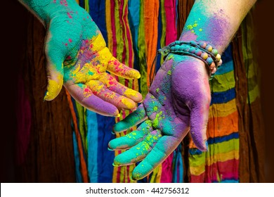 Colorful holi painted hands in different positions