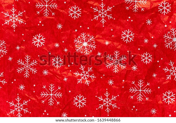 Colorful holiday Christmas crumpled wrapping paper background.