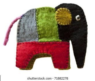 Colorful homemade toy felt elephant isolated on white background
