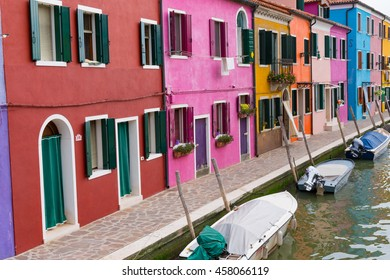 Colorful homes along a canal in Burano, Italy