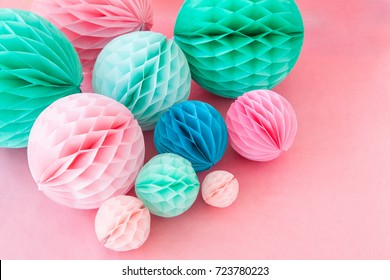 Colorful honeycomb balls on pink for a party