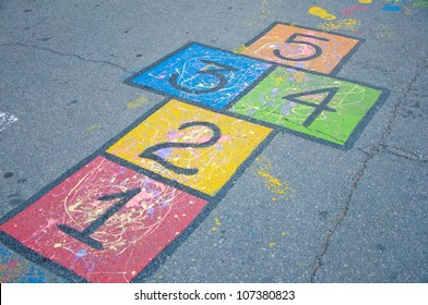 A colorful hopscotch game painted on the ground