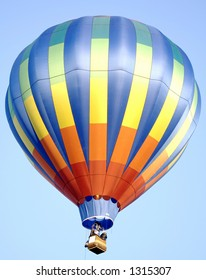 A colorful hot air balloon in a bright blue sky