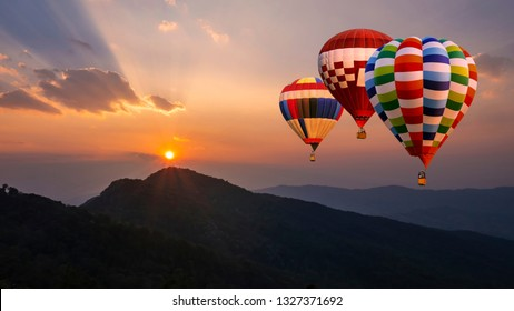 Colorful hot air balloon fly over mountain view with sunlight at  Chiangrai, Thailand