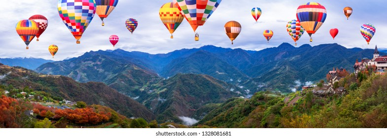 Colorful hot air balloon fly over panorama nature landscape of mountain view from Cingjing Farm, Nantou, Taiwan (Switzerland of Taiwan)
