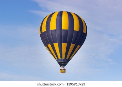 Colorful hot air balloon flying on sky. travel and air transportation concept