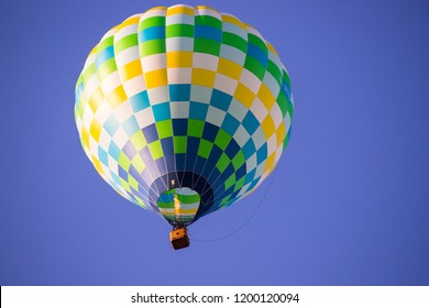 Colorful hot air balloon flying over blue sky