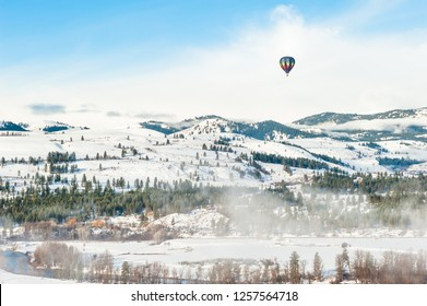 Colorful hot air balloon flying in the blue sky. Fun and happiness. A relaxing flying experience.
