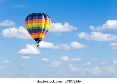Colorful hot air balloon on blue sky background