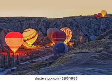 Colorful hot air balloons before launch   at Cappadocia, Turkey. Volcanic mountains in Goreme national park.
