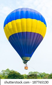 Colorful Hot Air Balloons in Flight over blue sky. Soft focus on balloon