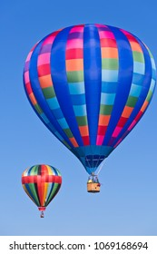 Colorful Hot Air Balloons Floating in the Bright Blue Clear Morning Sky