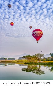 Colorful hot air balloons floating above the lake in Chiang Rai, Thailand