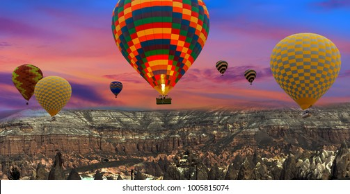 Colorful hot air balloons flying over landscape at Cappadocia Turkey