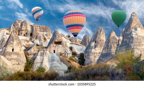Colorful hot air balloons flying over valley in Cappadocia, Anatolia, Turkey