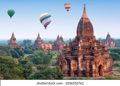 Colorful hot air balloons flying over Bagan Archaeological zone, Mandalay division, Myanmar. Bagan's prosperous economy built over 10000 temples between 11th and 13th centuries.