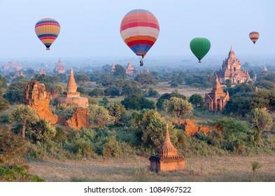 Colorful hot air balloons flying over Bagan at sunrise. Mandalay division, Myanmar