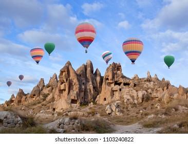 Colorful hot air balloons flying over Cappadocia, Central Anatolia, Turkey