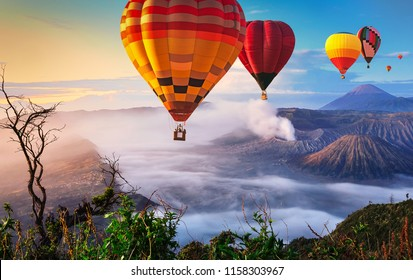 Colorful hot air balloons flying over Mount Bromo, Java, Indonesia.
